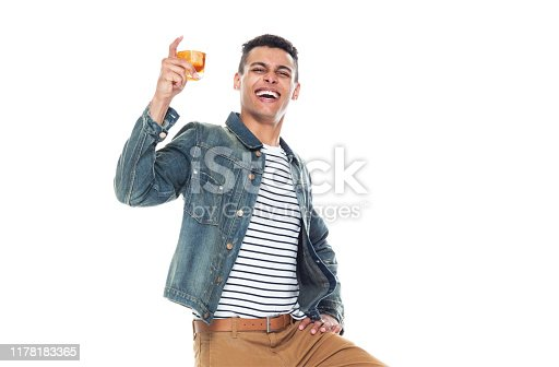 istock One person / full length / front view / waist up of 20-29 years old adult handsome people / tall person african ethnicity / african-american ethnicity male / young men standing in front of white background wearing denim jacket / cool attitude 1178183365