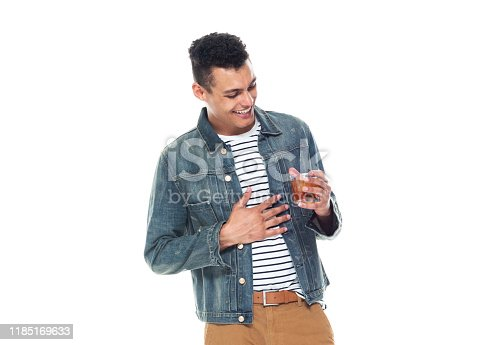 istock One person / full length / front view / waist up of 20-29 years old adult handsome people / tall person african ethnicity / african-american ethnicity male / young men standing in front of white background wearing denim jacket / cool attitude 1185169633