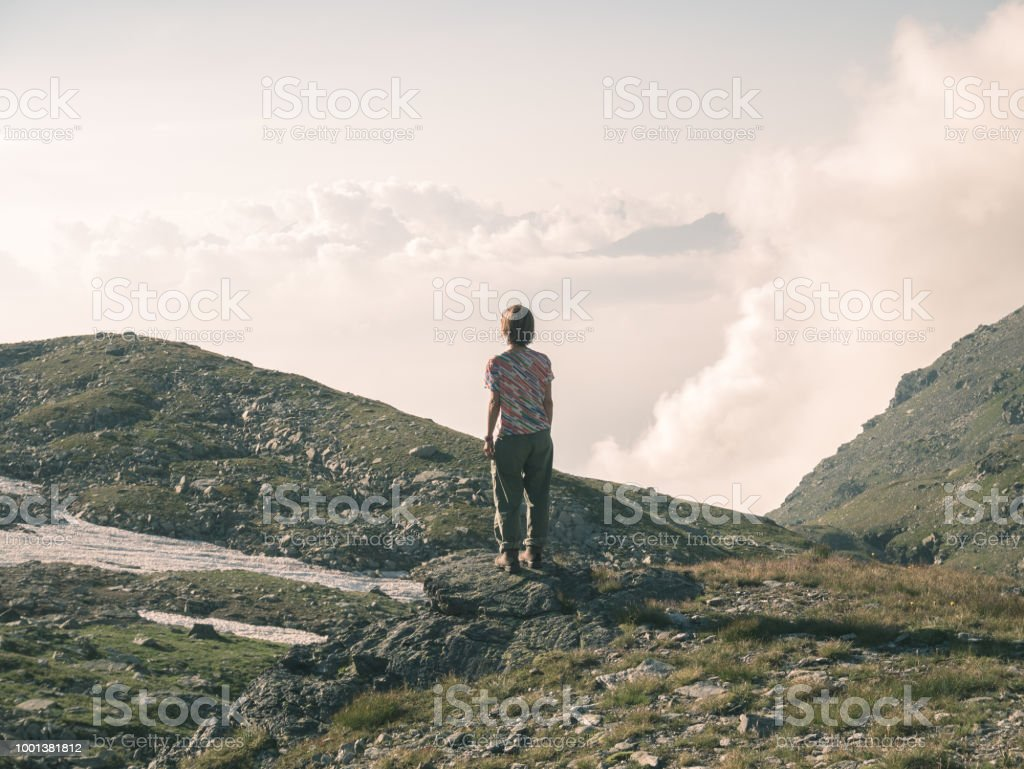 One person looking at view high up on the Alps. Expasive landscape,...