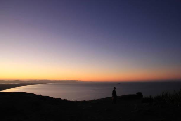 Eine Person Silhouette, Neuseeland – Foto