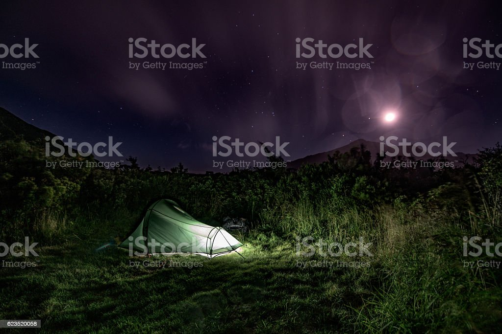 One person's tent under a night sky stock photo