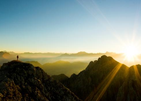 a climber observing sunset.