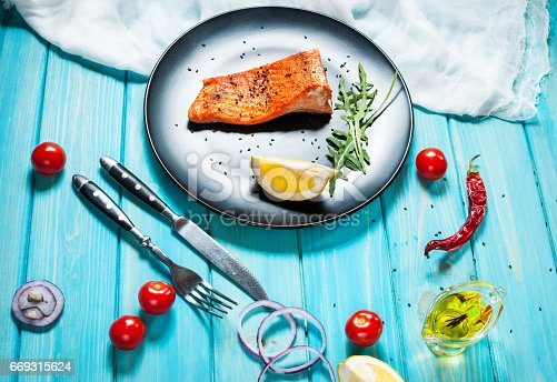 655794674istockphoto One piece of baked salmon with lemon 669315624