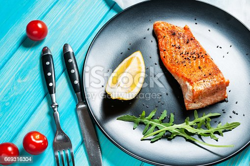 655794674istockphoto One piece of baked salmon with lemon 669316304