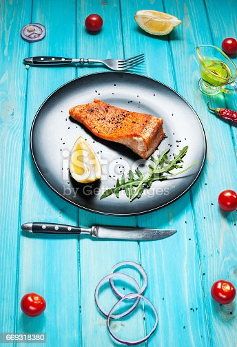 655794674istockphoto One piece of baked salmon with lemon 669318380