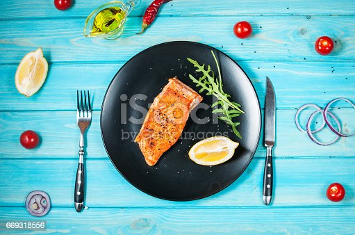 655794674istockphoto One piece of baked salmon with lemon 669318556
