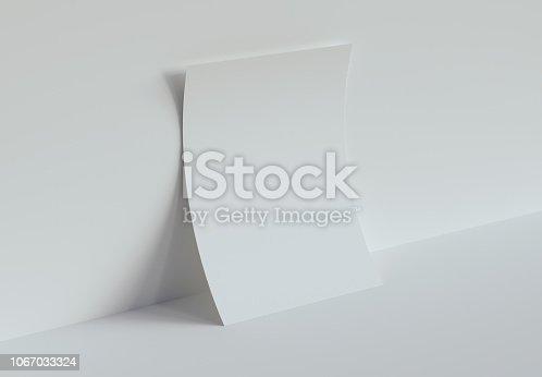 istock One Piece of Paper Mockup. 3d rendering. 1067033324