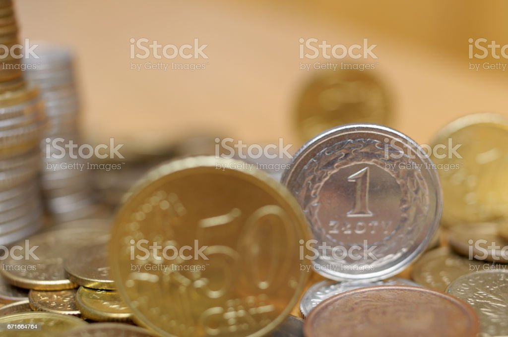 One polish złoty and fifty eurocent on the table stock photo