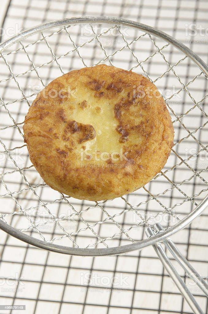 one potato cake on round spatula stock photo
