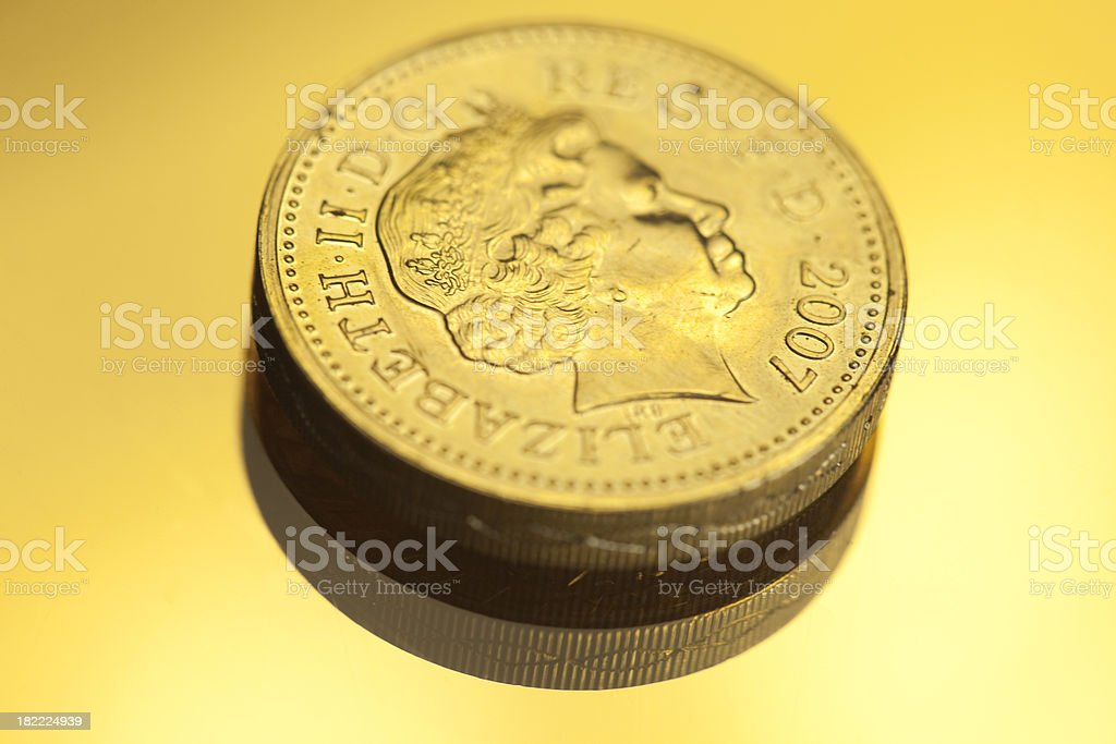 One Pound Coin In Gold royalty-free stock photo