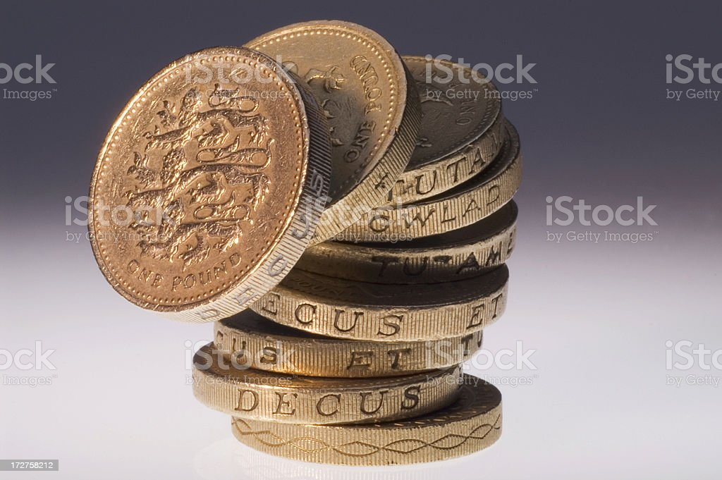 One Pound Coin Stack Falling royalty-free stock photo