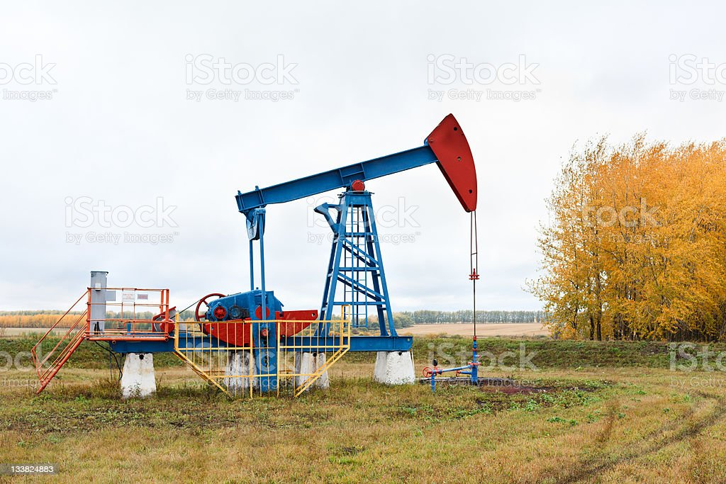 One pump jacks on a oil field royalty-free stock photo