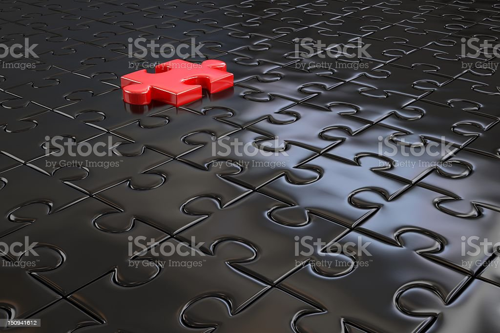 One red 3D jigsaw puzzle piece on top of all black pieces stock photo