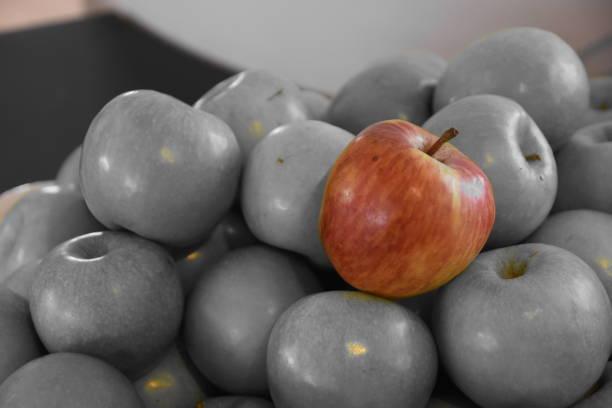 One red apple between green apples - foto stock