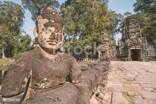 One remaining statue of warrior in the Gate of Angkor Thom complex, Siem Reap, Cambodia