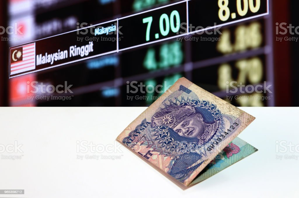 One ringgit banknote of Malaysia on the white floor on digital board of currency exchange money background. royalty-free stock photo