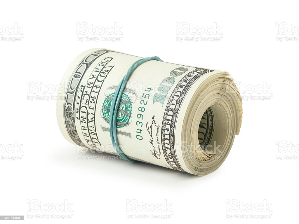 One roll from dollars on white background stock photo