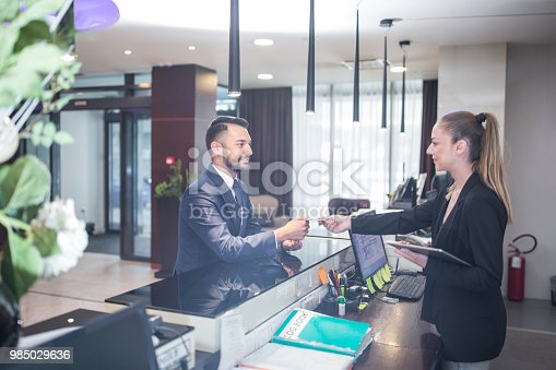 Businessman checking in at the hotel reception