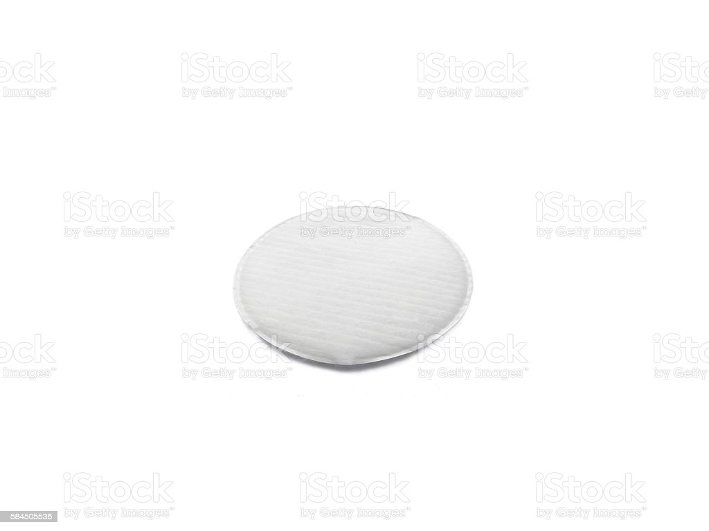 One round cosmetic cotton pad isolated on white stock photo