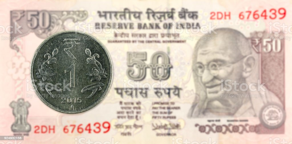 One Rupee Coin Against 50 Indian Rupee Bank Note Obverse