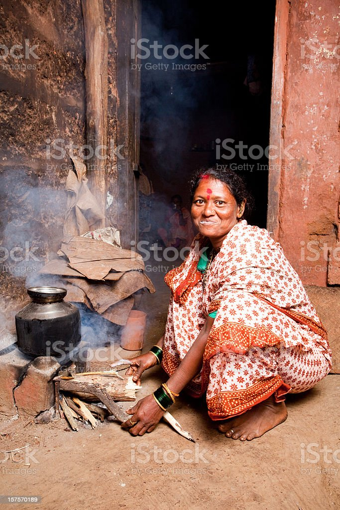 One Rural Indian Woman preparing food royalty-free stock photo