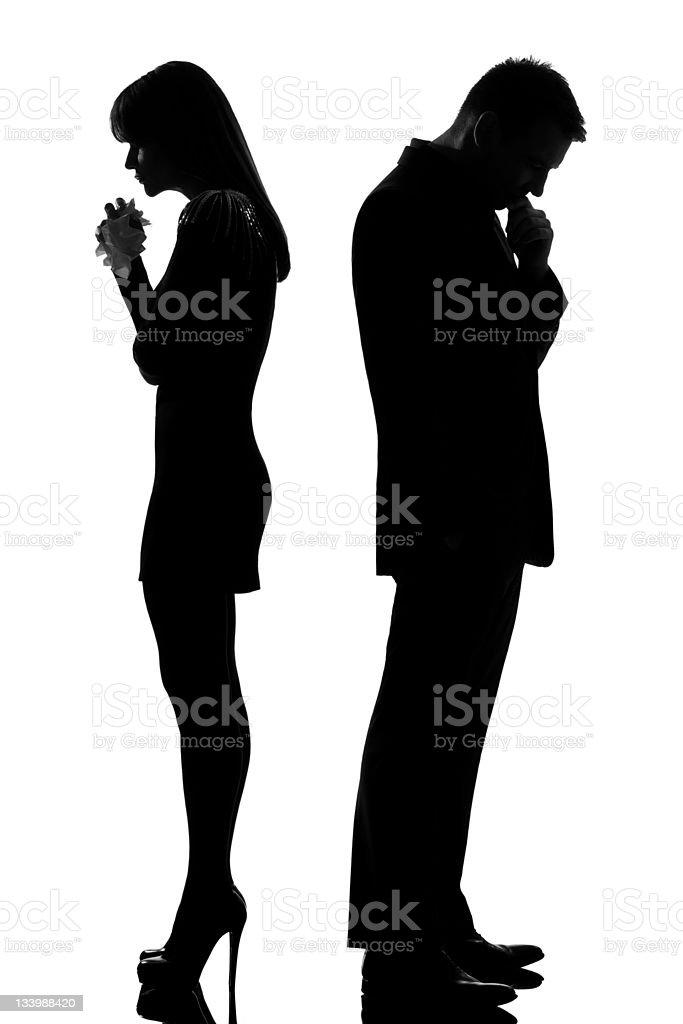 one sad couple man thinking and woman crying royalty-free stock photo