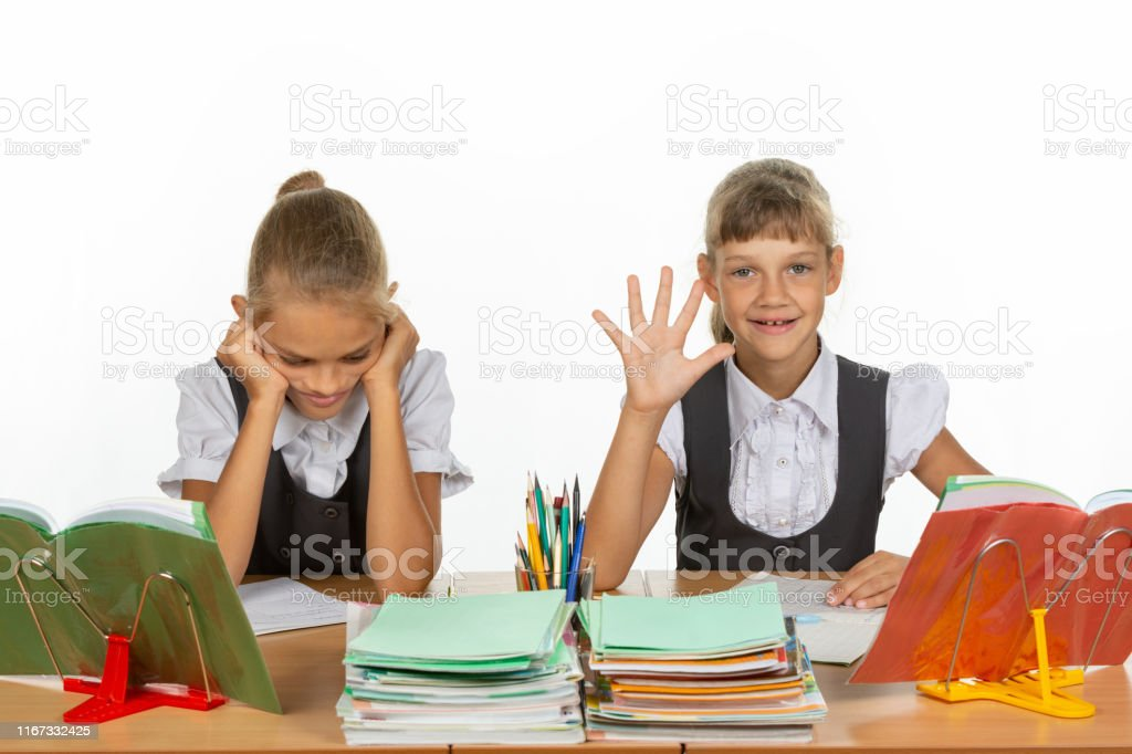 One schoolgirl received a rating of five, the second two One schoolgirl received a rating of five, the second two Back Stock Photo