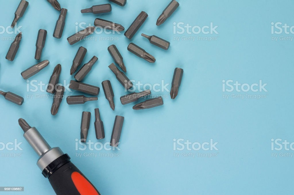 One screwdriver with rubber handle of black and orange color and...