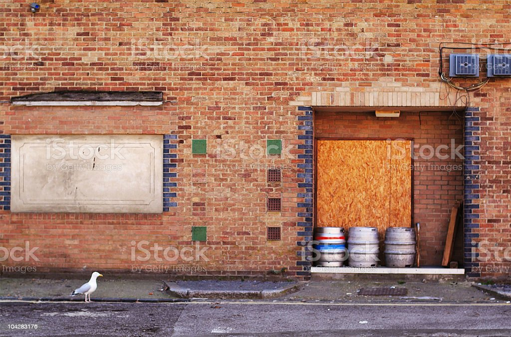 One seagull and three barrels outside a pub royalty-free stock photo