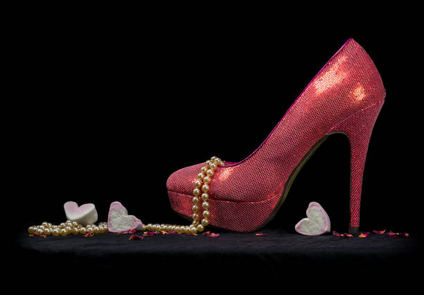 one sexy shoe, pearls and hearts, black background. - glitzer absätze stock-fotos und bilder