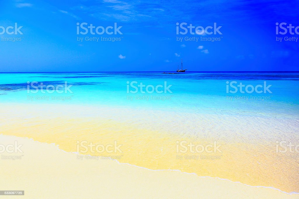 One ship and secluded beach, Caribbean Blue sea stock photo