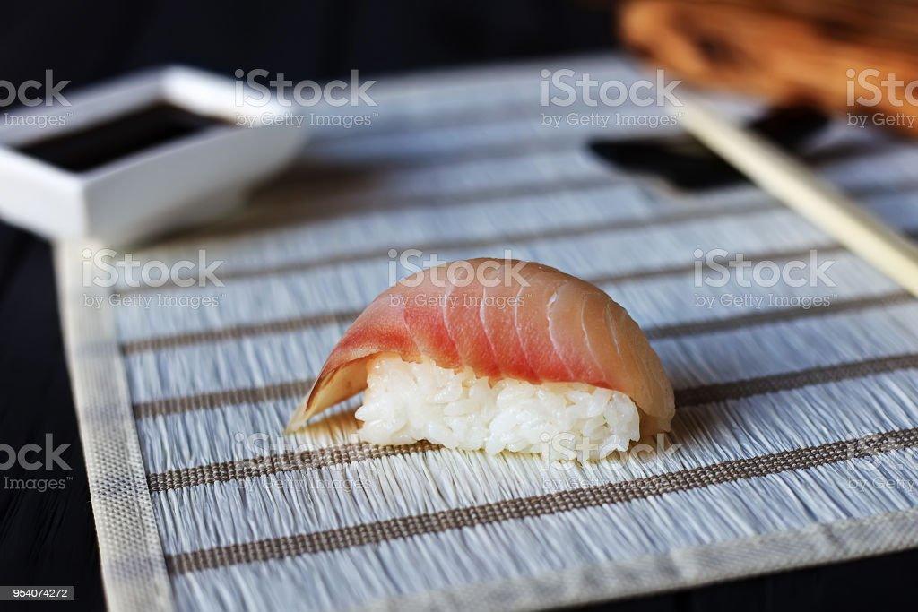 One shrimp sushi nigiri with delicious prawn served on white str stock photo