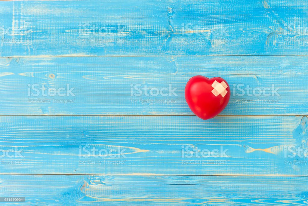 One single alone red heart love shape hand exercise ball on the blue...