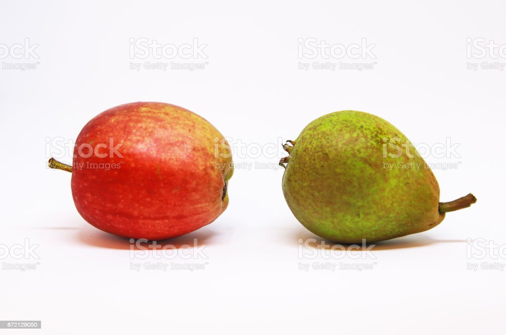 One single apple and one pear picked in the fuit district of Hardanger, Norway stock photo