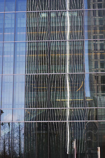 skyscraper reflection - whiteway money stock photos and pictures