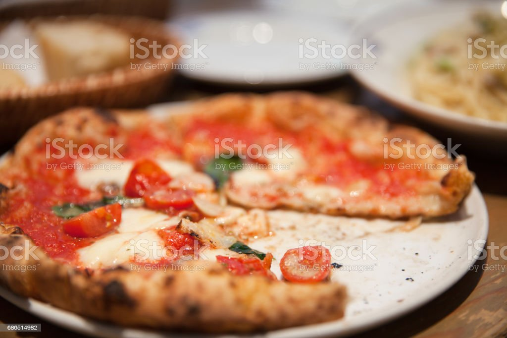 One slice missing pizza stock photo