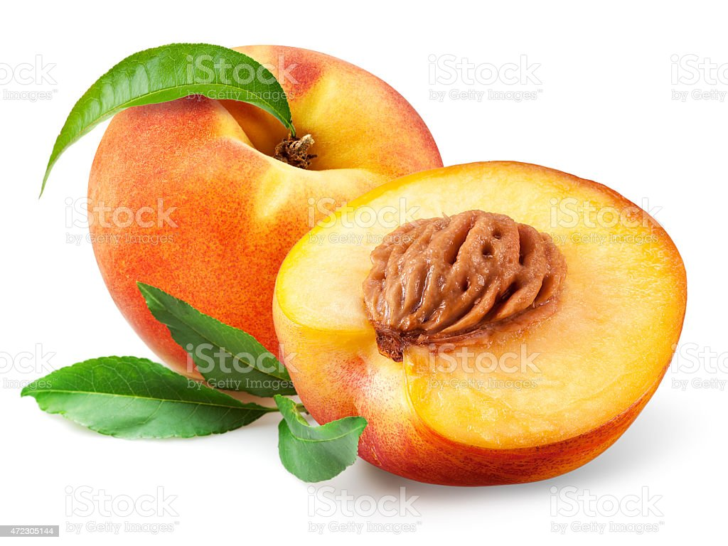 One sliced and one whole ripe peach isolated on background stock photo