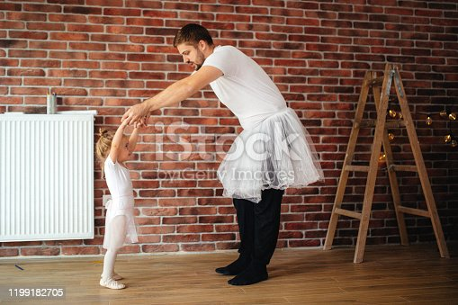 Father and daughter learning to dance ballet