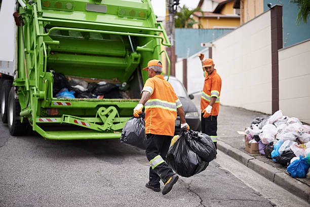 One street at a time... Cropped shot of a garbage collection team at work street sweeper stock pictures, royalty-free photos & images