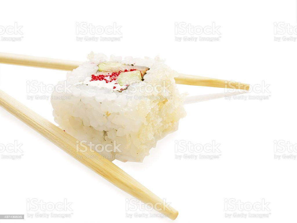 one sushi roll with chopsticks over white royalty-free stock photo