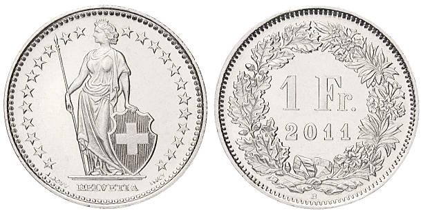 one swiss franc on white background - franken stockfoto's en -beelden