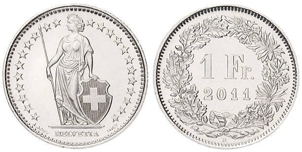 One Swiss Franc on white background stock photo