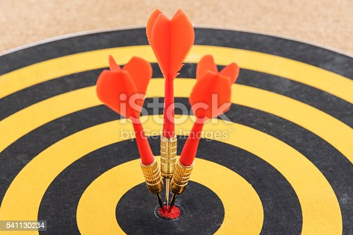 886643538 istock photo One target with three dart arrows hitting the bullseye 541130234