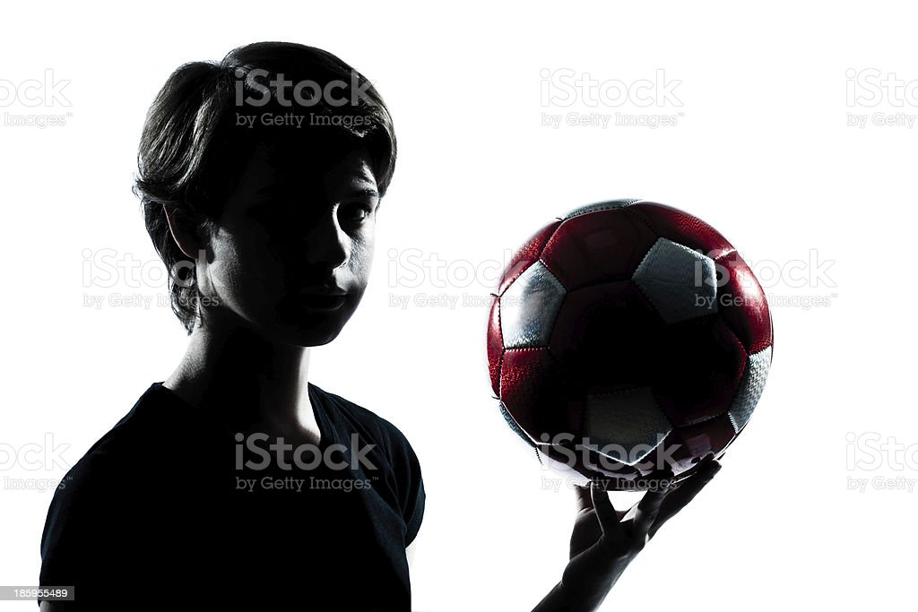 one  teenager boy  girl silhouette holding showing soccer football stock photo