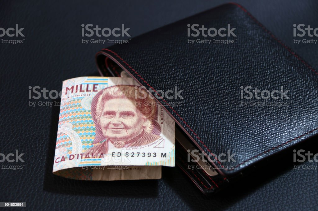 One thousand Lire of Italy banknote with black wallet on the black floor. royalty-free stock photo