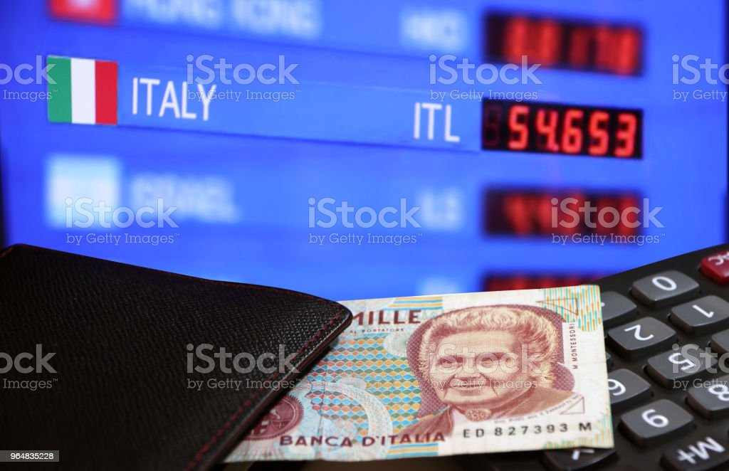 One thousand Lire of Italy banknote with black wallet on the calculator with digital board of currency exchange money background. royalty-free stock photo