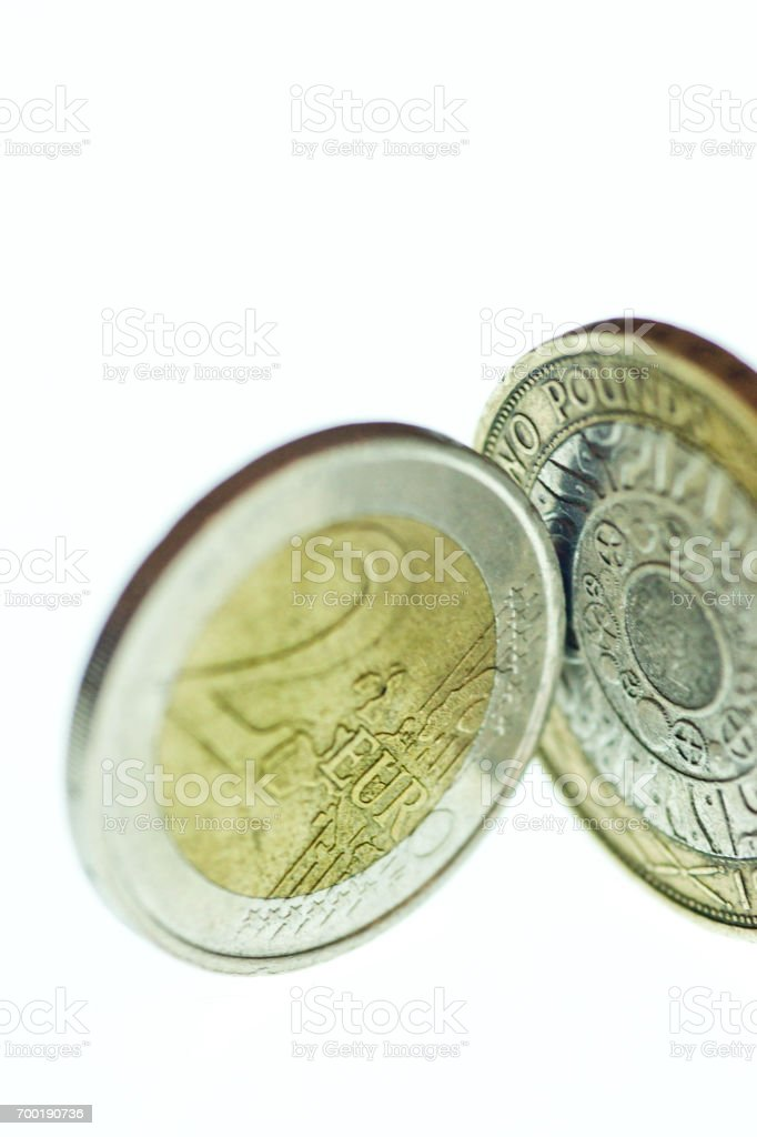 One two euro coin and one two pound coin stock photo