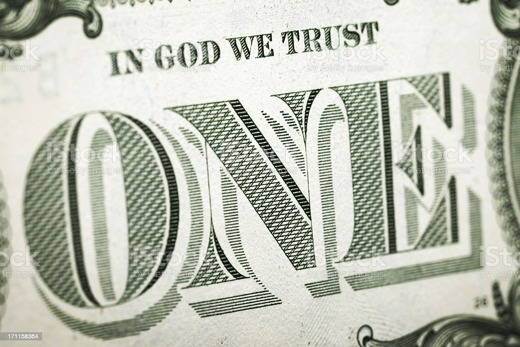 One U.S. Dollar with Detail on In God We Trust stock photo