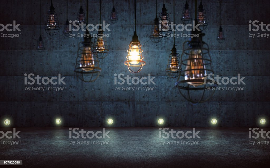 One vintage style light bulb standing out from other bulbs,rustic cement wall background , leadership and business ideal success concept . stock photo