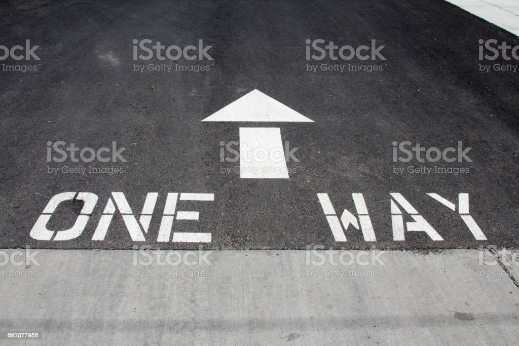 One way painted on asphalt with arrow stock photo